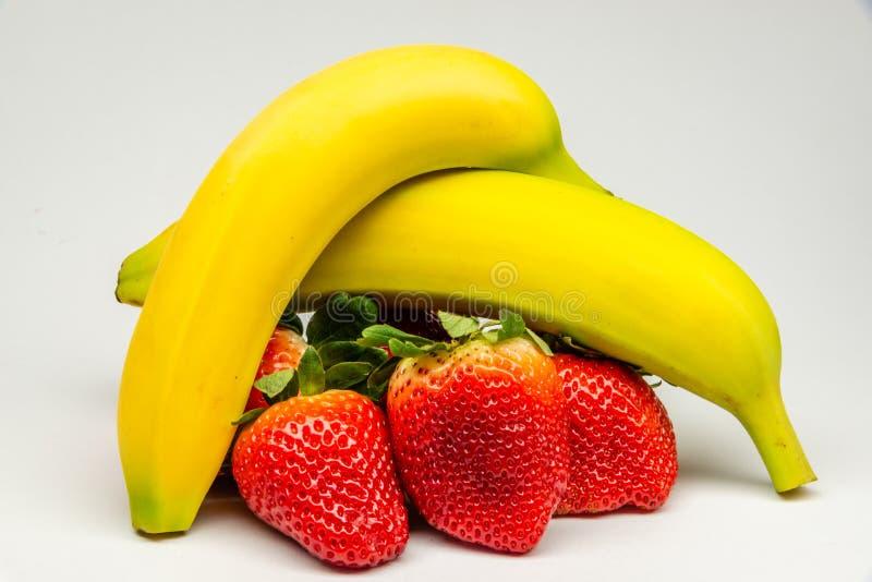 Banana and strawberries close-up photo stock image