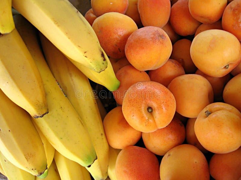 Bananas and apricots stock photos