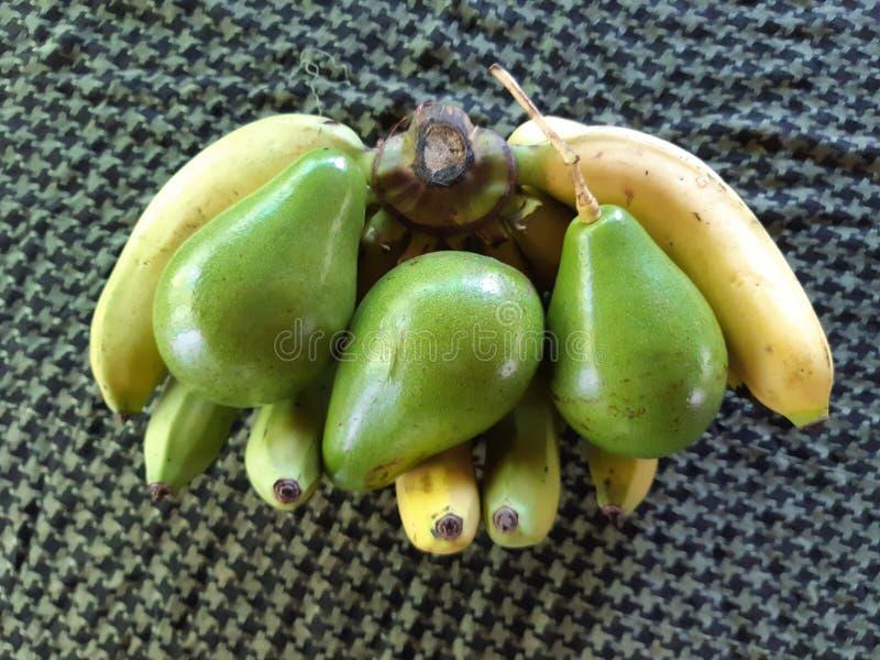 Bananas and avocados stock photo