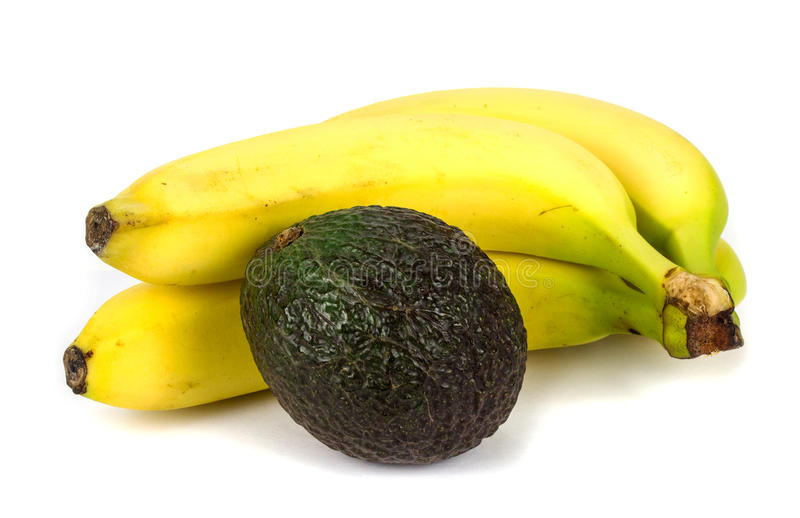 Bananas and avocados on a white background stock images