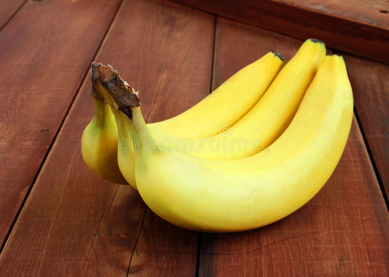 Download Bananas On Dark Wood Background With Copyspace Stock Image - Image: 24978133
