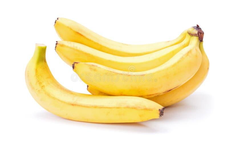 Bananas em um fundo branco do estúdio imagem de stock royalty free