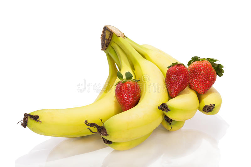 Bananas and strawberries. On a white background royalty free stock photography