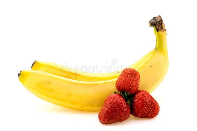 Bananas and strawberries on white. Background isolated stock photo