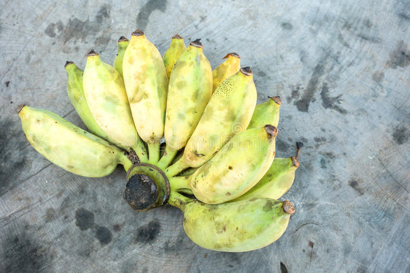 Bananas on the wooden table at the farm. stock photo