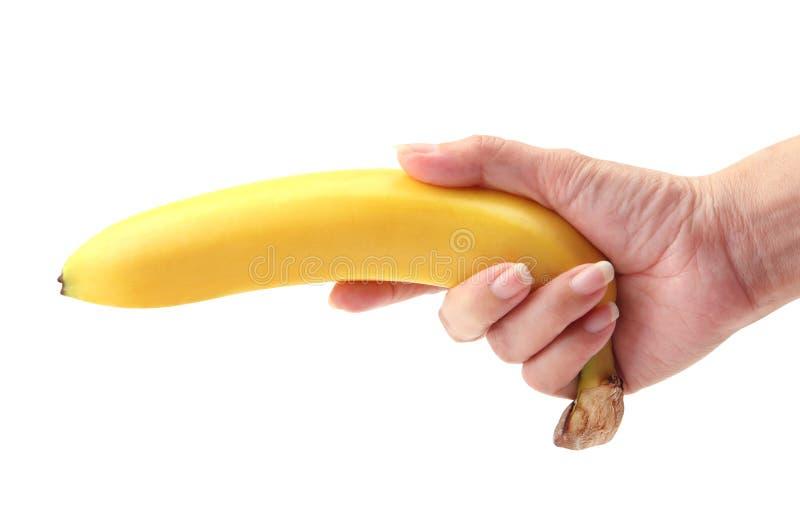 Banane à disposition photographie stock