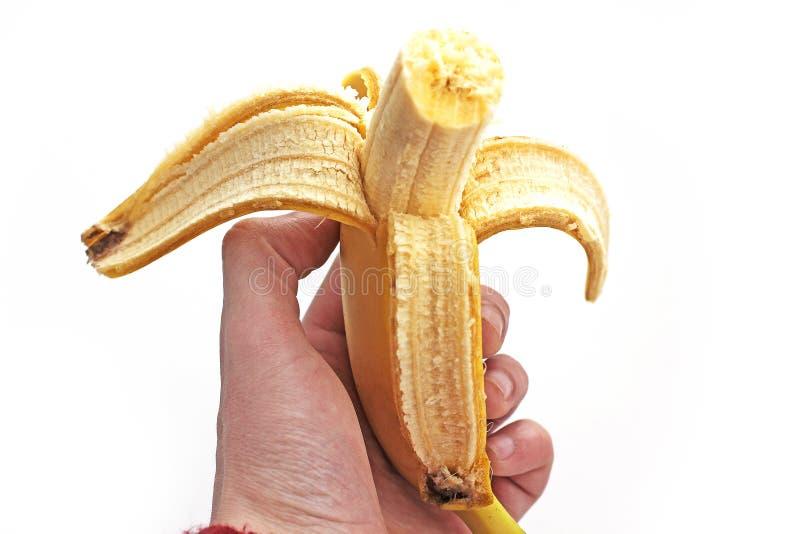 Banane à disposition sur le fond blanc photographie stock