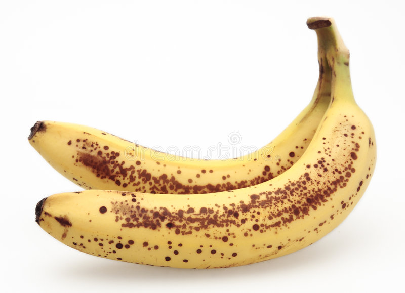 Banane avec les taches brunes photo stock