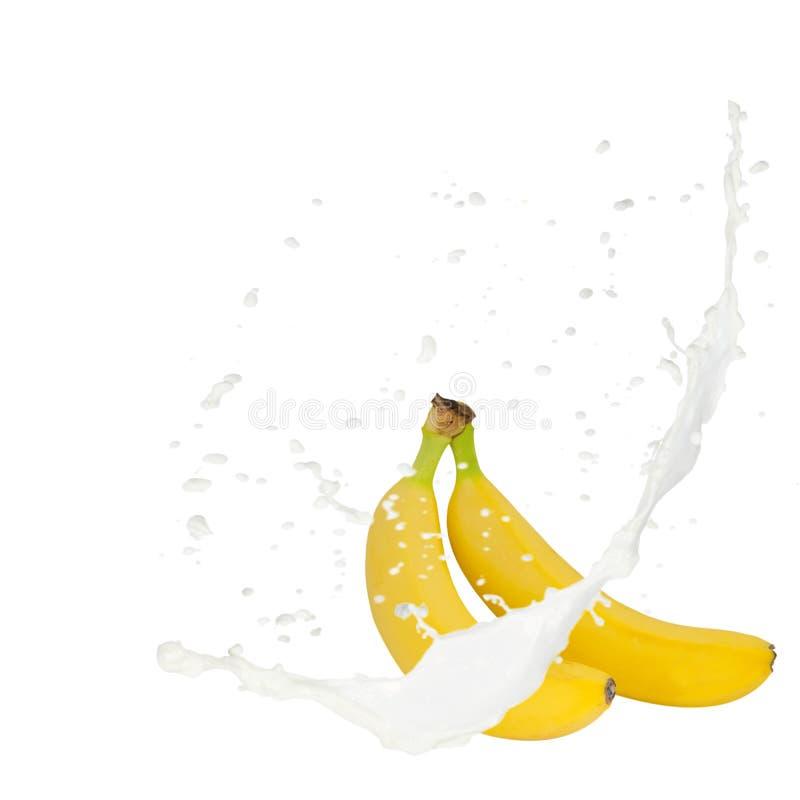 Banane d'éclaboussure de lait photographie stock