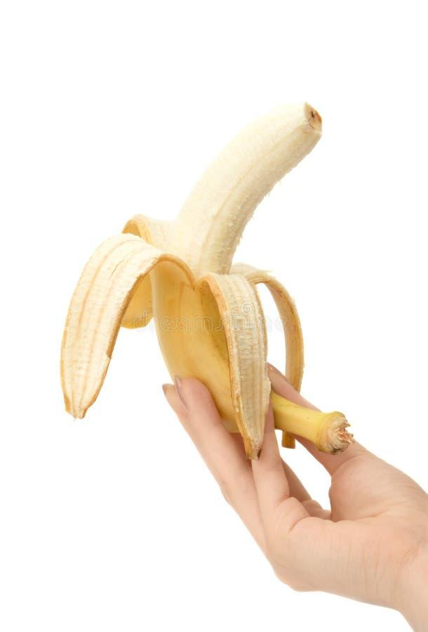 Banane in der Hand lizenzfreies stockfoto
