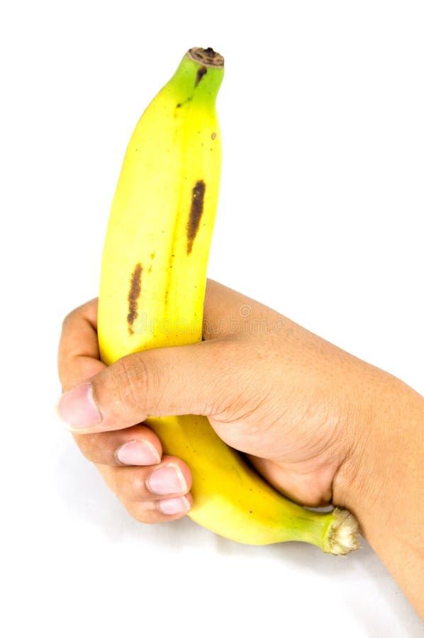 Banane in der Hand stockfotos