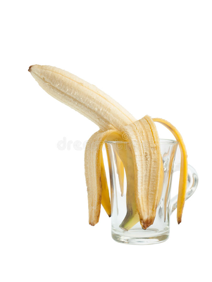 Banane in einem Glas stockfotografie