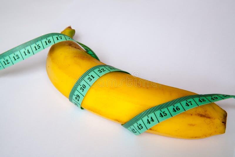 Banane mit einem Machthaber lizenzfreie stockbilder