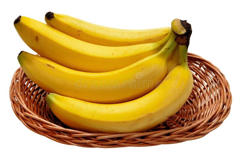 Banane sui precedenti bianchi fotografia stock