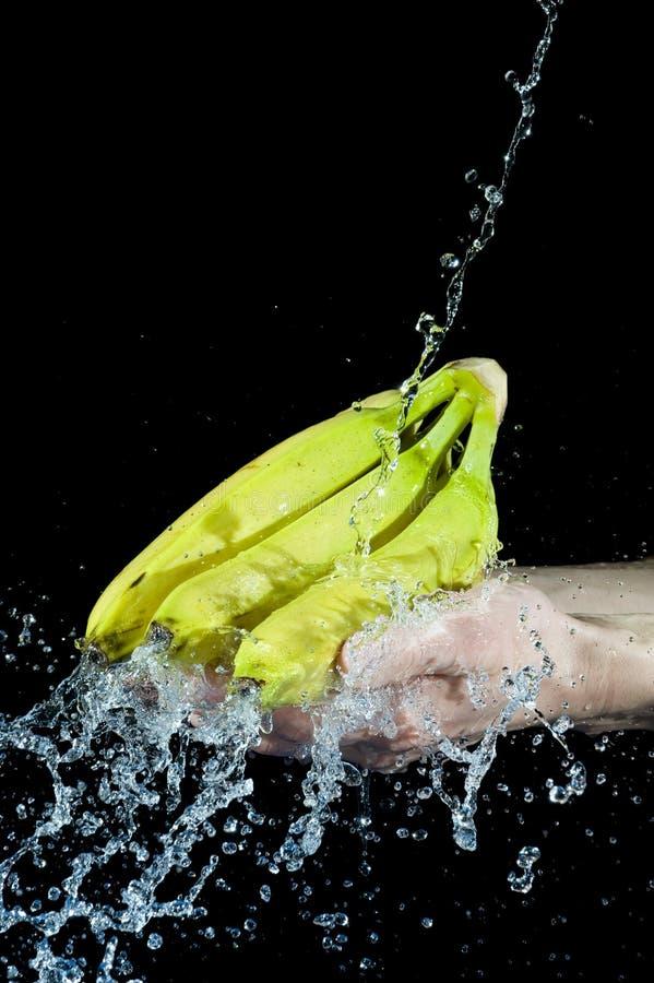 Banane und Wasser stockbild