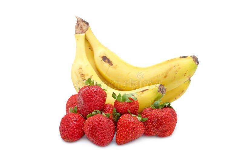 Bananen en aardbeien royalty-vrije stock foto's