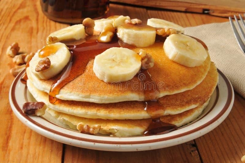 Bananennusspfannkuchen lizenzfreie stockfotos
