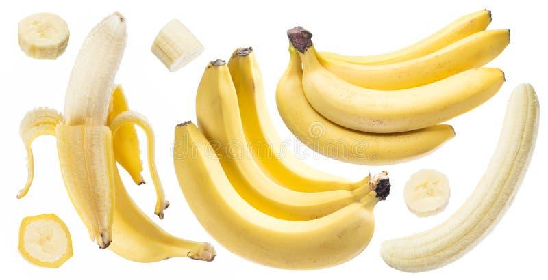 Bananes et tranches de banane sur le fond blanc images libres de droits