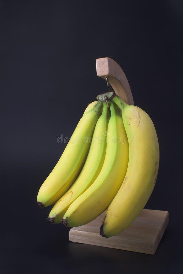 Banany na haczyku zdjęcia royalty free