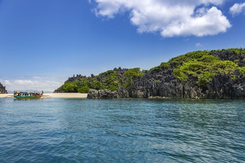 Banca on Lahus Island beach, Caramoan, Camarines Sur Province, Luzon in the Philippines. Banca boat on Lahus Island beach in the municipality of Caramoan stock image