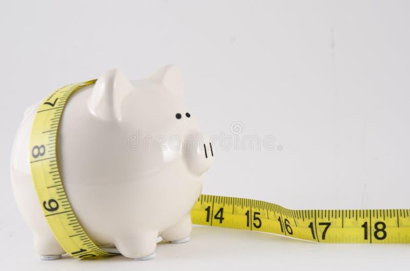 Banca Piggy con nastro adesivo di misura fotografia stock