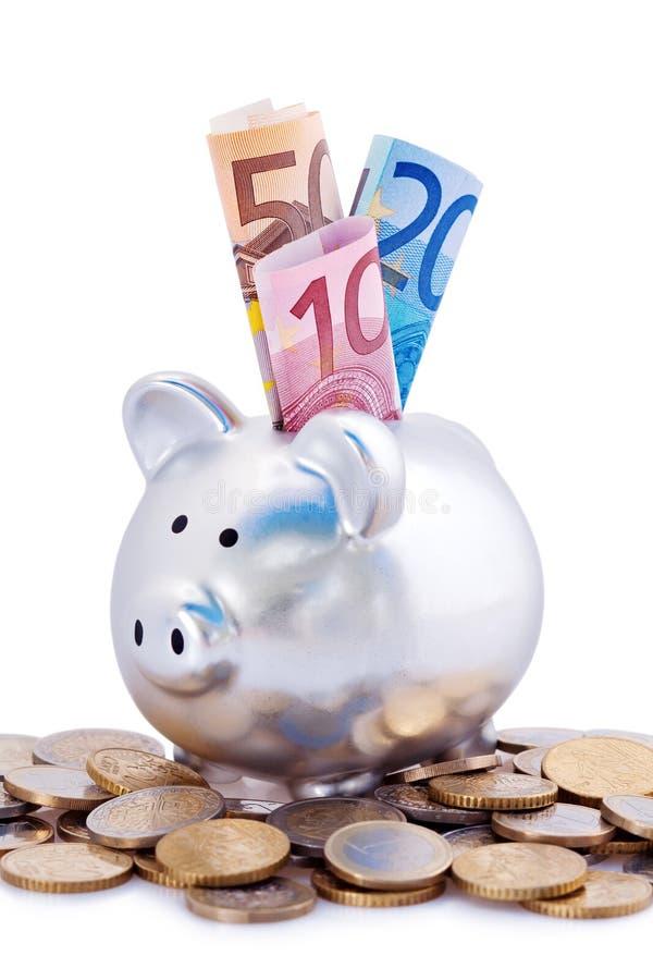 Banca piggy d'argento con gli euro immagine stock libera da diritti