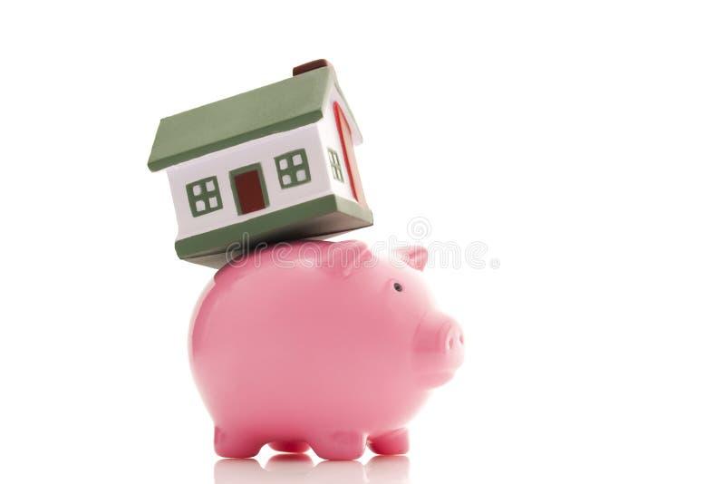Banca Piggy e casa fotografia stock