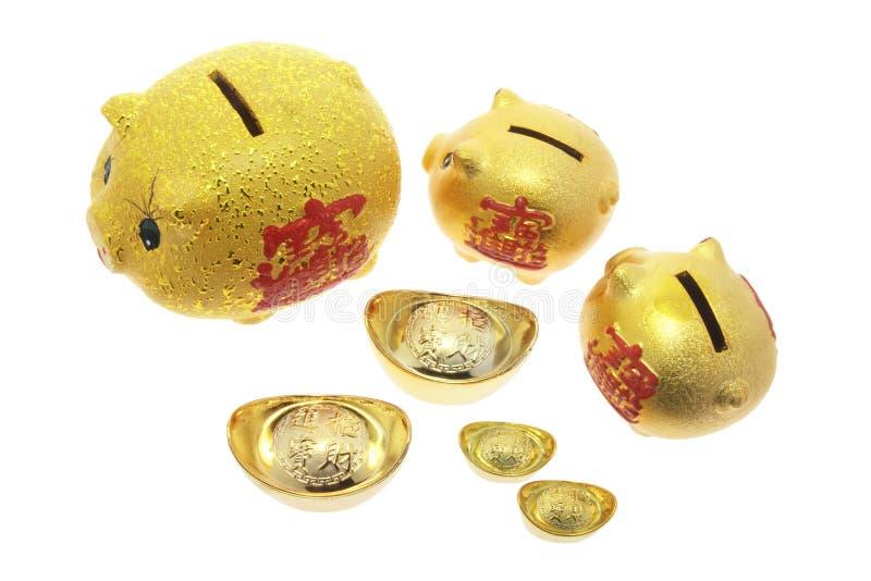Download Banche Piggy E Lingotti Dell'oro Fotografia Stock - Immagine di pepite, colpi: 7318188