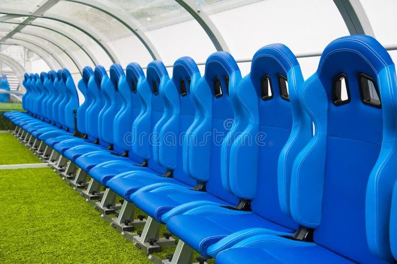 Banco o asiento o silla azul del coche del personal en el estadio del foo fotografía de archivo libre de regalías