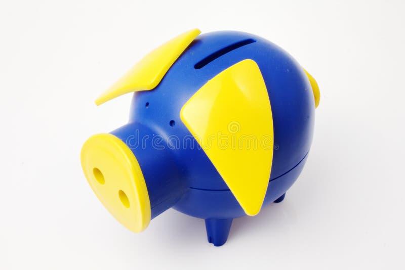 Banco Piggy azul e amarelo fotografia de stock royalty free