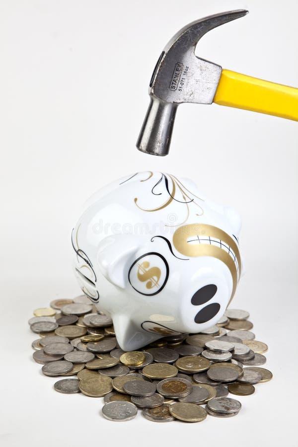 Banco Piggy batido com martelo foto de stock royalty free