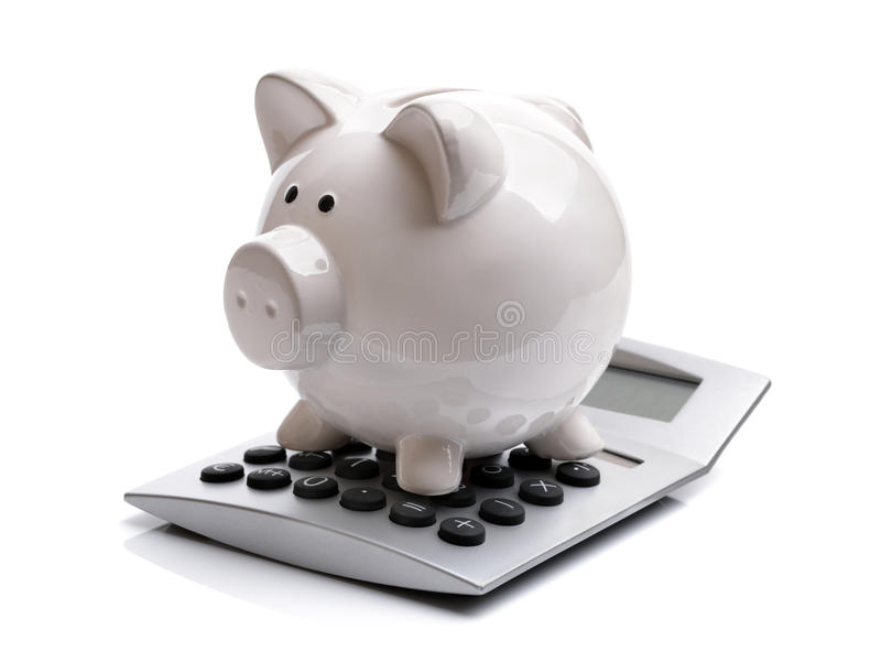 Banco Piggy com calculadora imagens de stock