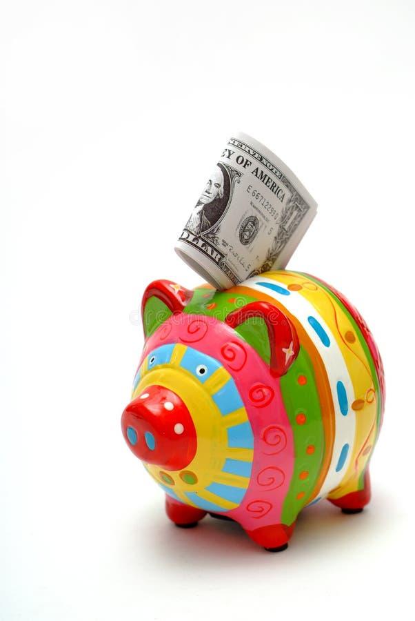 Banco Piggy com dólares americanos fotografia de stock