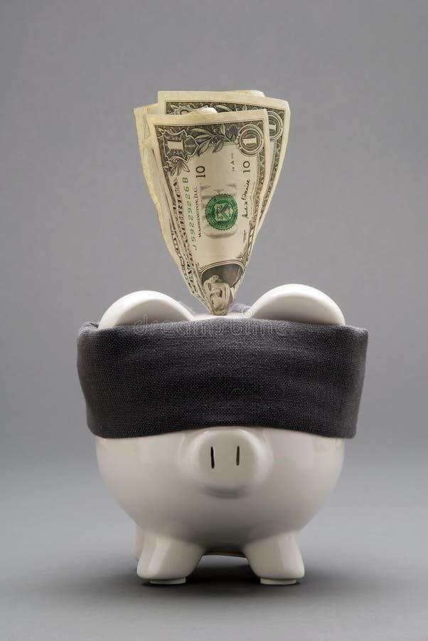 Banco Piggy de olhos vendados fotografia de stock