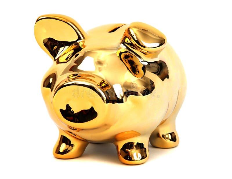 Banco piggy dourado de brilho brilhante fotografia de stock