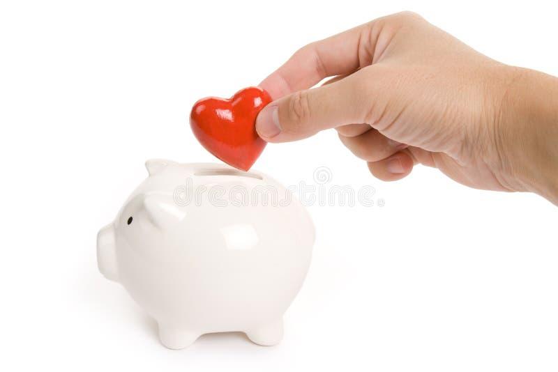 Banco Piggy e coração vermelho imagens de stock