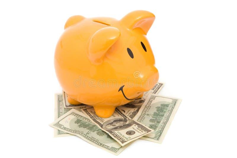 Banco Piggy e dólares imagens de stock
