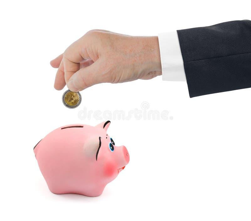 Banco Piggy e mão com moeda fotos de stock