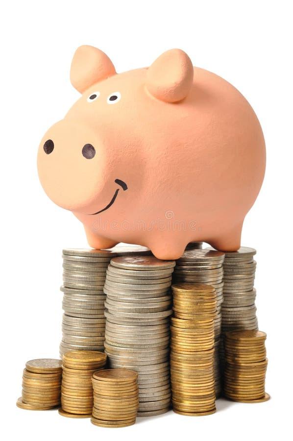 Banco Piggy e moedas imagens de stock