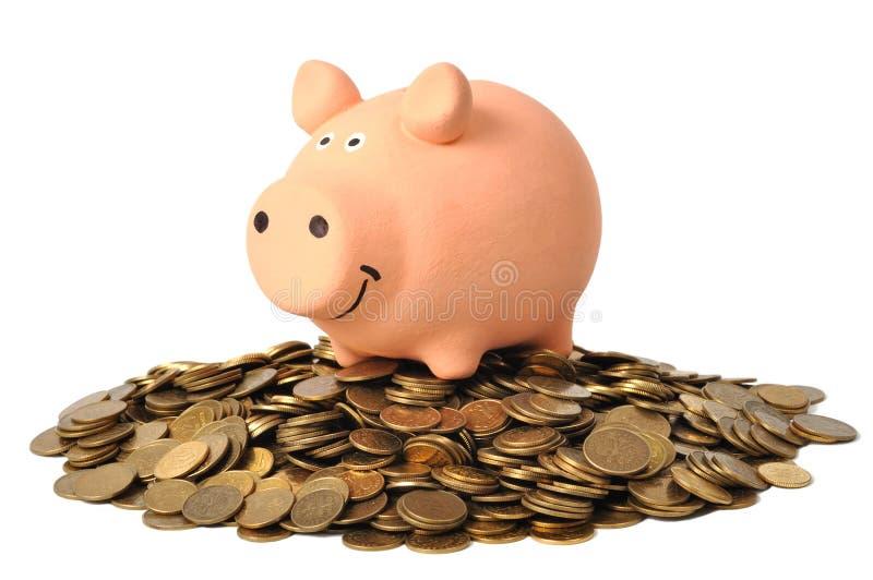 Banco Piggy e moedas foto de stock