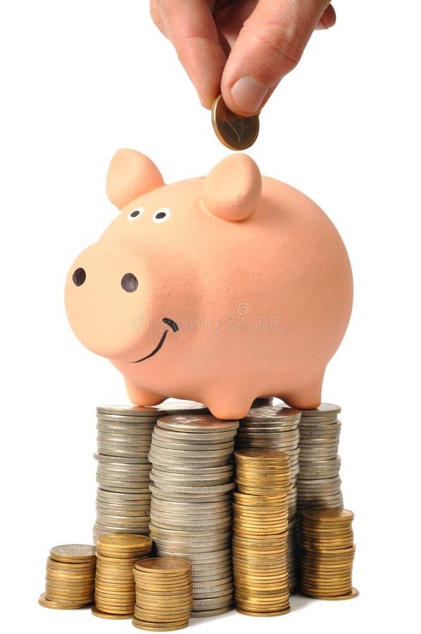 Banco Piggy e moedas fotos de stock