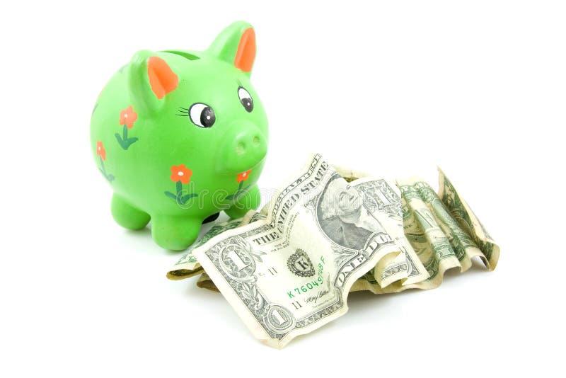 Banco Piggy Verde Com Dólares Fotografia de Stock Royalty Free