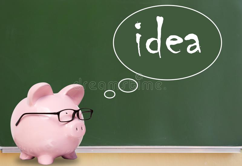 Banco y pensamientos del cerdo Idea imagen de archivo