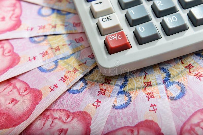 Banconota cinese e calcolatore del rmb dei soldi fotografia stock libera da diritti