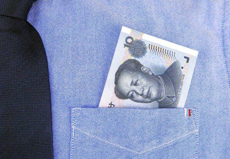 Banconota di RMB in tasca della camicia fotografia stock