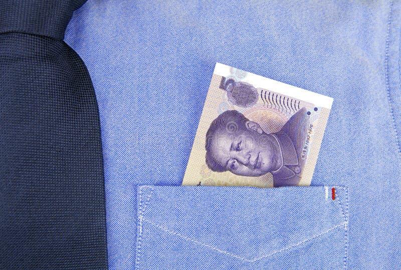 Banconota di RMB in tasca della camicia immagine stock