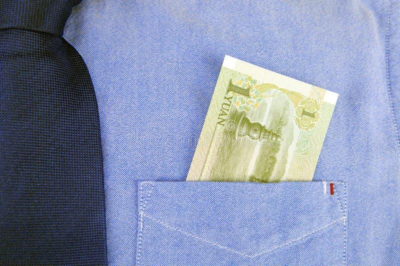 Banconota di RMB in tasca della camicia immagini stock