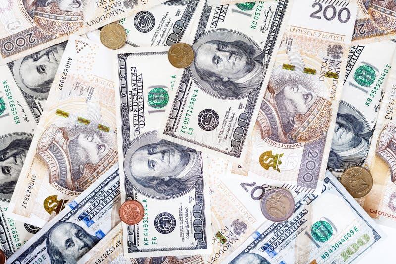 Banconote del dollaro americano e della zloty polacca, soldi fotografia stock
