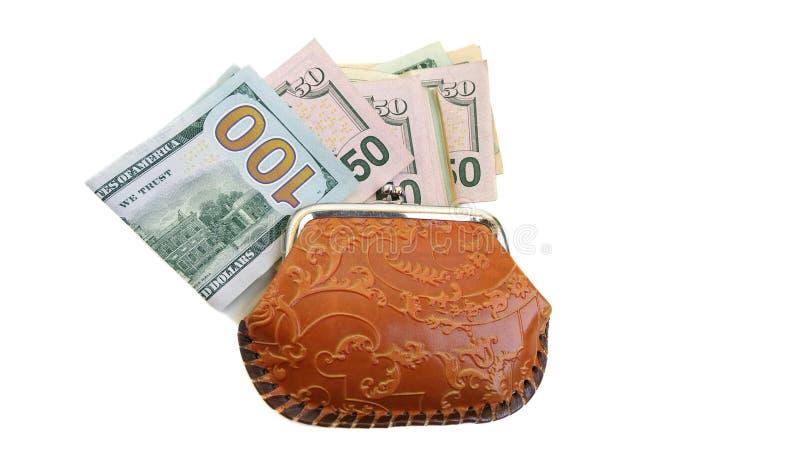 Banconote del dollaro e una borsa sul bianco fotografia stock