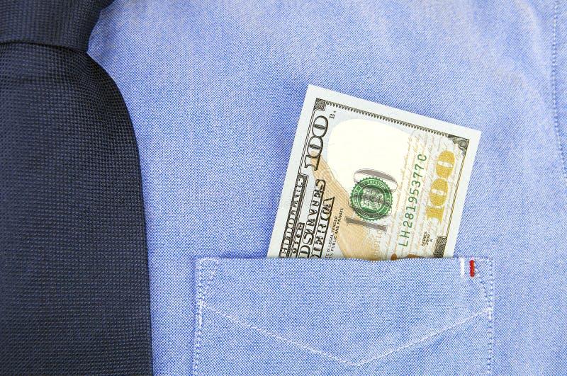 Banconote del dollaro in tasca della camicia fotografia stock